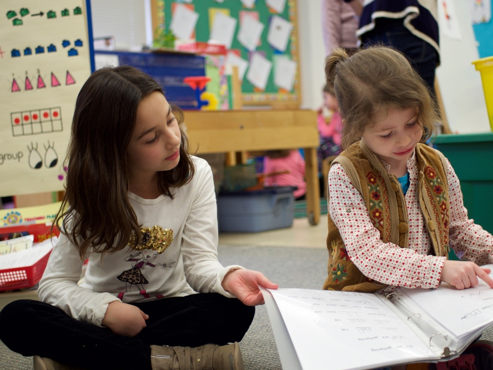 Slideshow: Kindergarten student reads to her second grade buddy